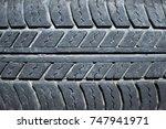 worn black car tire texture | Shutterstock . vector #747941971