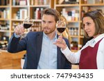 couple enjoying and drinking... | Shutterstock . vector #747943435