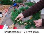 woman making christmas wreath | Shutterstock . vector #747951031