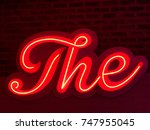 photo of a red neon sign with... | Shutterstock . vector #747955045
