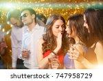 party people dancing in club.... | Shutterstock . vector #747958729