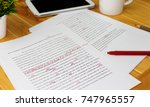 Stock photo hand working on paper for proofreading 747965557
