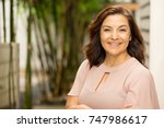 mature hispanic woman smiling. | Shutterstock . vector #747986617