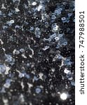 Small photo of Fabric texture, background, black sequined.tinsel, trumpery, frippery, gaud, gewgaw, gimcrack