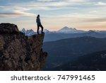 adventurous man is standing on... | Shutterstock . vector #747991465