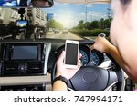 man using a smart phone while... | Shutterstock . vector #747994171