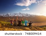 group of six happy friends is... | Shutterstock . vector #748009414