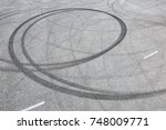 Small photo of Abstract background black tire tracks skid on asphalt road, high angle shot view in racing circuit