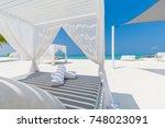 luxury beach resort. summer... | Shutterstock . vector #748023091