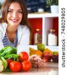 young woman standing near desk... | Shutterstock . vector #748029805