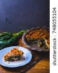 spinach pie. dark and moody... | Shutterstock . vector #748055104