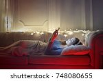 relaxing with music  | Shutterstock . vector #748080655