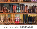 Cowboy Boots On A Shelf In A...