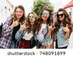 portrait of fashionable young... | Shutterstock . vector #748091899