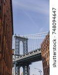 manhattan bridge seen from a... | Shutterstock . vector #748094647