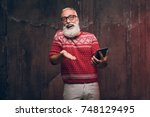 happy senior man communicates... | Shutterstock . vector #748129495
