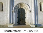 old doors at the entrance to... | Shutterstock . vector #748129711