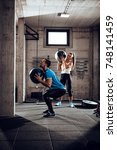 young muscular couple having... | Shutterstock . vector #748141459
