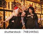 cheerful happy friends having... | Shutterstock . vector #748144561