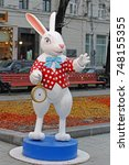 "Small photo of Moscow, Russia - December 21, 2015: White Rabbit with a clock from ""Alice in Wonderland"" on Tverskoy Boulevard at the festival ""Journey to Christmas"" in Moscow"
