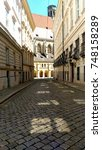 Small photo of Romantic alley in Vienna on a sunny day.