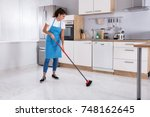 smiling young housemaid... | Shutterstock . vector #748162645