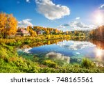 autumn landscape with wooden... | Shutterstock . vector #748165561