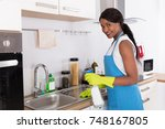african young woman cleaning... | Shutterstock . vector #748167805