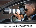 private detective sitting... | Shutterstock . vector #748170817