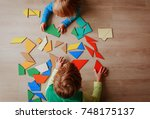 kids playing with puzzle ... | Shutterstock . vector #748175137