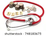 Small photo of World AIDS day on a white background.AIDS (Acquired Immune Deficiency Syndrome on the table with stethoscope, medical concept.