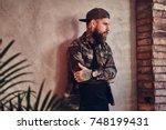 bearded man posing over the... | Shutterstock . vector #748199431