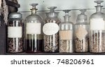 Small photo of Six antique medicine bottles on shelf with blank labels