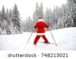 santa claus skier with skis in... | Shutterstock . vector #748213021