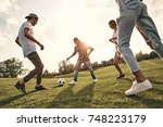 playful friends. group of young ... | Shutterstock . vector #748223179