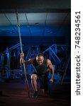 young male athlete bodybuilder... | Shutterstock . vector #748234561