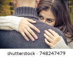 a hugging couple. the girl is... | Shutterstock . vector #748247479