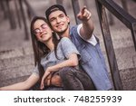 stylish young couple is hugging ... | Shutterstock . vector #748255939