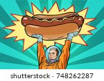cosmonaut and hot dog fast food.... | Shutterstock .eps vector #748262287