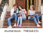 young students studying while... | Shutterstock . vector #748266151