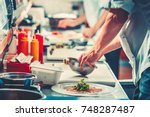 two young chefs in white... | Shutterstock . vector #748287487