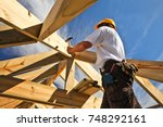 roofer  carpenter working on... | Shutterstock . vector #748292161