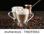 glass cups with latte macchiato ... | Shutterstock . vector #748293061