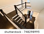 interior staircase in new home. ... | Shutterstock . vector #748298995