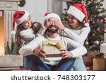merry christmas and happy new... | Shutterstock . vector #748303177
