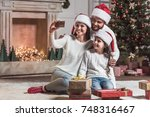 merry christmas and happy new... | Shutterstock . vector #748316467