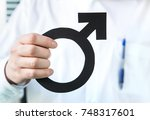 male health concept. doctor... | Shutterstock . vector #748317601