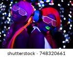 2 sexy cyber glow raver women... | Shutterstock . vector #748320661