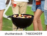 friends cooking food on... | Shutterstock . vector #748334059