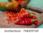 red pepper on the wood | Shutterstock . vector #748359769